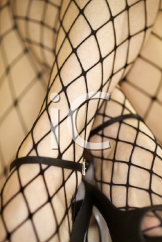 Royalty Free Photo of a Close-up of a Woman in Fishnet Stockings and High Heels