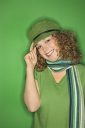 Royalty Free Photo of a Smiling Woman Wearing a Green Hat