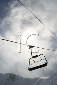 Royalty Free Photo of an Empty Chair Lift at a Ski Resort