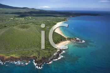 Royalty Free Photo of an Aerial View of a Crater on Maui, Hawaii Coast With Beach