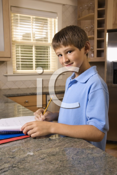 Royalty Free Photo of a Pre-Teen Boy Doing His Homework