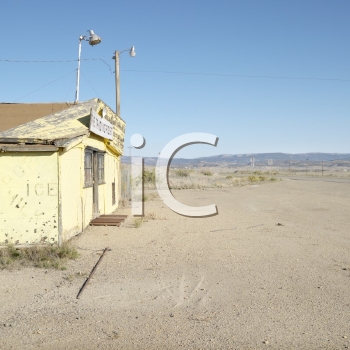 Royalty Free Photo of an Old Trading Post in a Desert Landscape of Utah