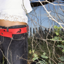 Royalty Free Photo of a Woman's Torso With a Red Belt