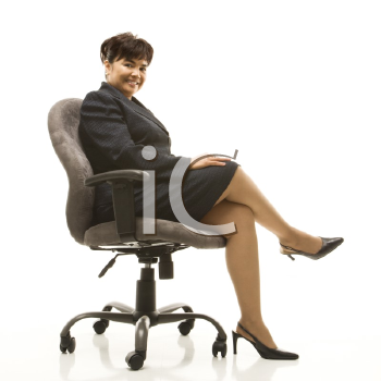Royalty Free Photo of a Businesswoman Sitting in a Office Chair