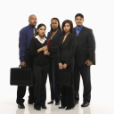 Royalty Free Photo of a Multi-Ethnic Business Group Standing Holding Briefcases