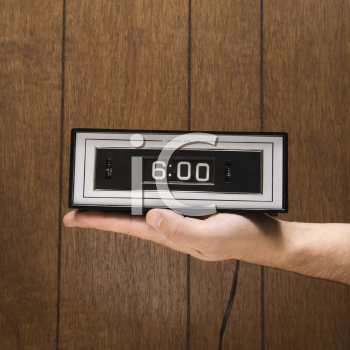 Royalty Free Photo of a Man Holding a Retro Alarm Clock