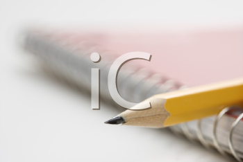 Royalty Free Photo of a Sharp Pencil Placed on a Spiral Bound Notebook