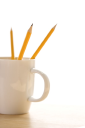 Royalty Free Photo of Pencils in a Coffee Mug With Pointed Ends Up