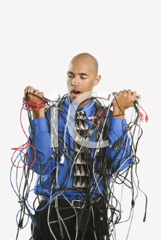 Royalty Free Photo of a Businessman Wrapped in Computer Cables