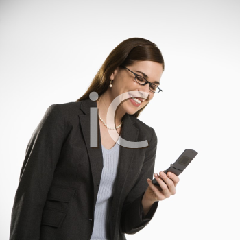 Royalty Free Photo of a Businesswoman Text Messaging on a Cellphone