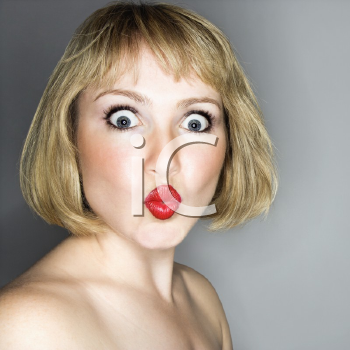 Royalty Free Photo of a Blonde Woman With a Look of Surprise