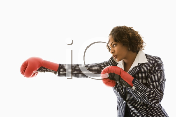 Royalty Free Photo of a Businesswoman Wearing Boxing Gloves Punching