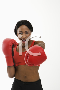 Royalty Free Photo of a Woman Wearing Boxing Gloves Throwing Playful Punches