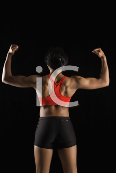 Royalty Free Photo of a Back View of a Muscular African American Woman With Biceps Flexed