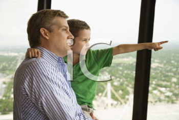 Royalty Free Photo of a Father and Son at the Observation Deck at Tower of the Americas in San Antonio, Texas