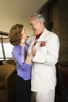 Royalty Free Photo of an Older Couple Dancing and Laughing