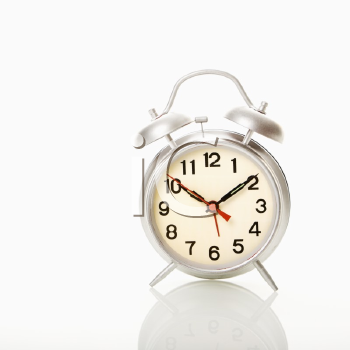 Royalty Free Photo of a Retro Style Alarm Clock
