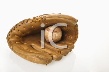Baseball resting in baseball glove.