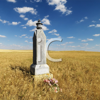 Royalty Free Photo of a Stone Burial Monument in a Field