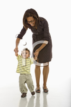 Royalty Free Photo of a Mother Teaching Her Toddler Son How to Walk