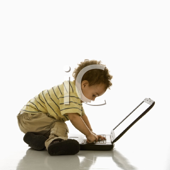 Royalty Free Photo of a Toddler Boy Using a Laptop