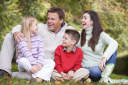 Royalty Free Photo of a Laughing Family Outside