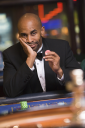 Royalty Free Photo of a Man at a Roulette Table