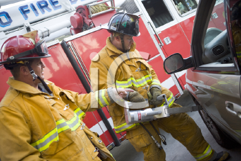 Royalty Free Photo of Firefighters Using the Jaws of Life