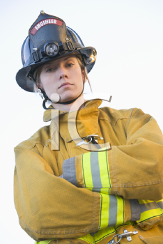 Royalty Free Photo of a Female Firefighter in a Bunker Suit