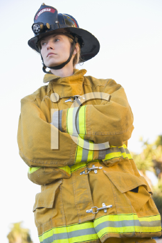 Royalty Free Photo of a Firefighter Standing Outdoors