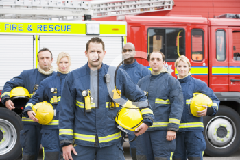 Royalty Free Photo of Firefighters in Front of the Rescue Vehicle