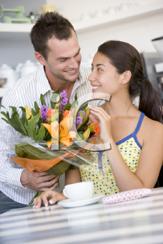 Royalty Free Photo of a Guy Giving a Girl Flowers