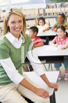 Royalty Free Photo of a Teacher in a Classroom