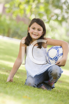 Royalty Free Photo of a Girl With a Soccer Ball