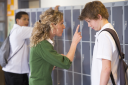 Royalty Free Clipart Image of a Student Being Reprimanded