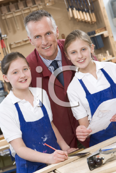 Royalty Free Photo of a Teacher and Woodworking Students