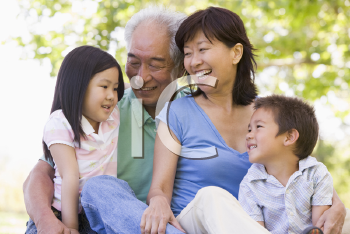 Royalty Free Photo of a Couple With Their Grandchildren