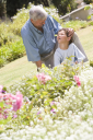 Royalty Free Photo of a Man and His Grandson in a Garden