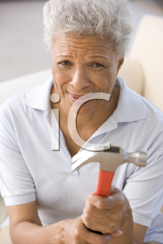 Royalty Free Photo of a Woman Holding a Hammer