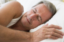Royalty Free Photo of a Man in Bed