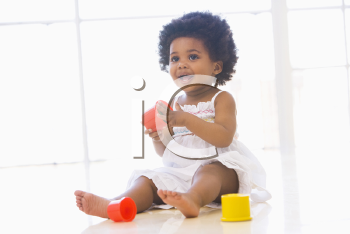 Royalty Free Photo of a Baby Playing With Blocks