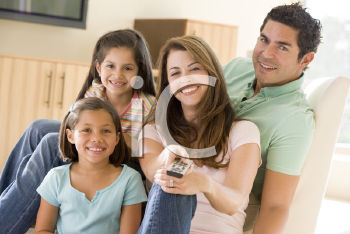 Royalty Free Photo of a Family Watching Television