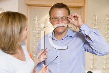 Royalty Free Photo of a Couple Trying on Glasses