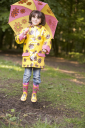 Royalty Free Photo of a Young Girl With an Umbrella