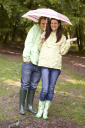 Royalty Free Photo of a Couple in the Rain