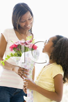 Royalty Free Photo of a Girl Giving Her Mother Flowers