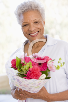 Royalty Free Photo of a Woman With Flowers