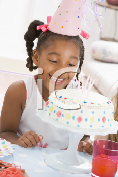 Royalty Free Photo of a Little Girl With a Birthday Cake