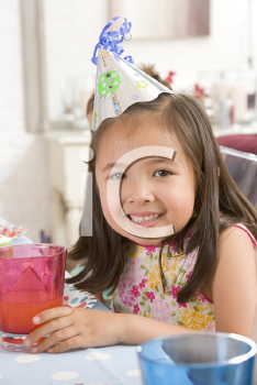 Royalty Free Photo of a Little Girl at a Birthday Party