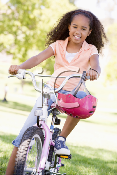 Royalty Free Photo of a Girl on a Bike